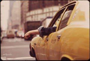 800px-CAB_DRIVER_WAITS_AT_INTERSECTION_IN_MIDTOWN_-_NARA_-_549862